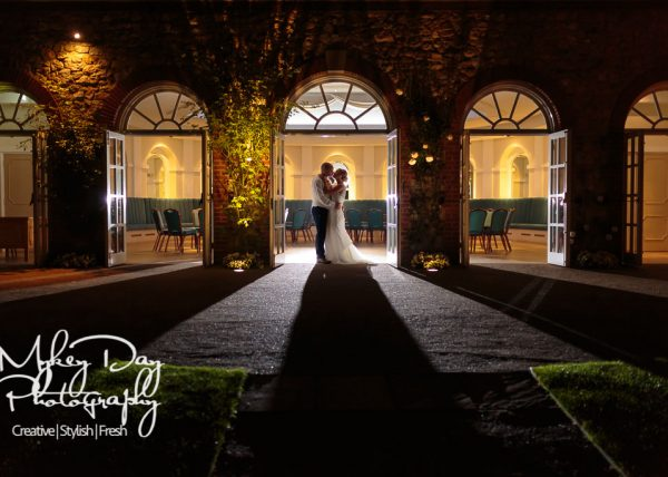 Turkey Mill Orangery Maidstone wedding photography, night time backlit wedding couple in wedding photo