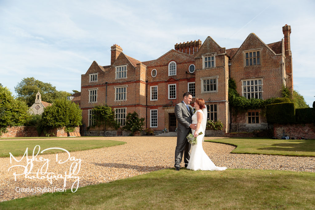 Knowlton court wedding venue photographer, main house with bride and groom in foreground