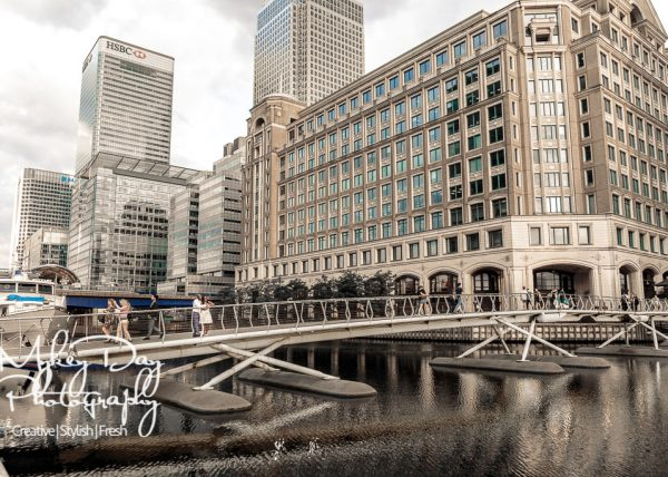 London Wedding photography, couple on bridge at Canary wharf, stunning architectural landscape pre-wedding photography