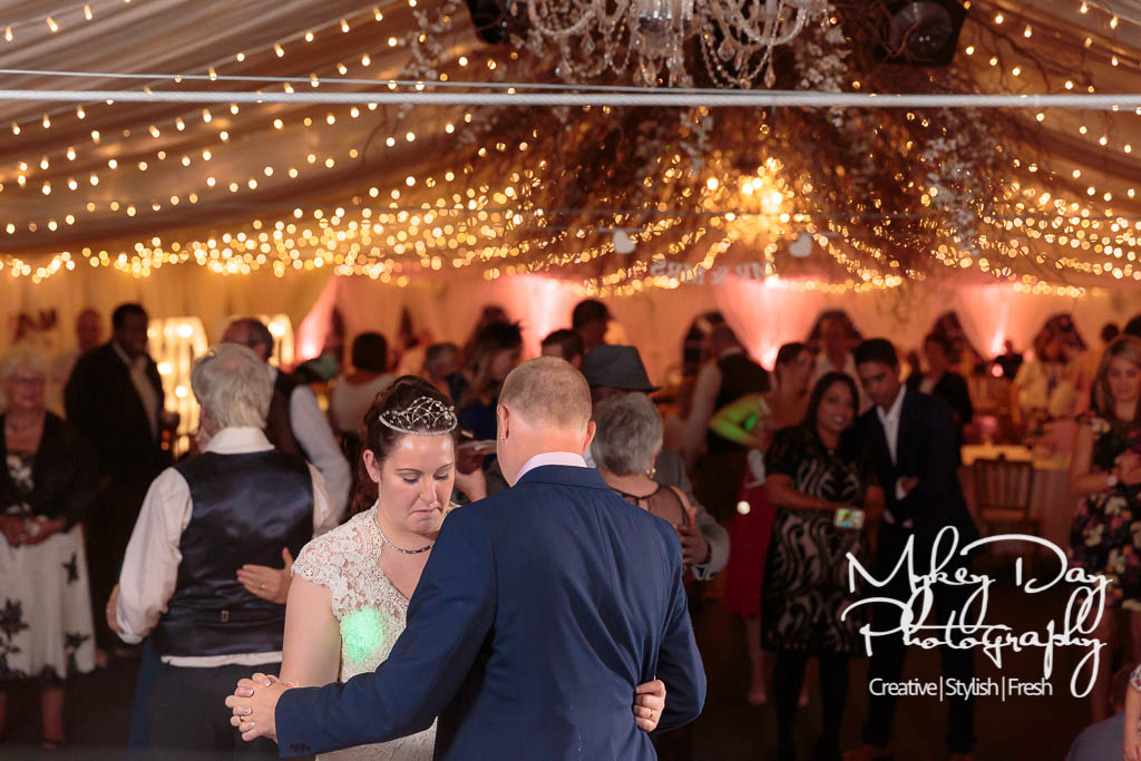 fairy lights first dance wedding photo at The Barnyard in Kent