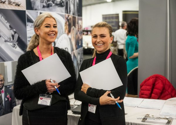 Wedding Fair exhibition girls holding notepads