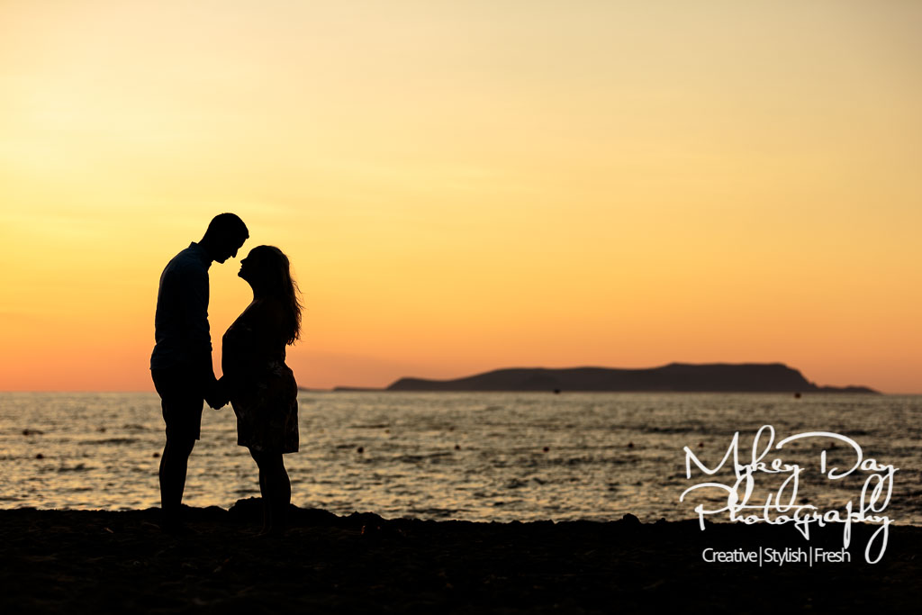 beach wedding photography, sunset in Crete with silhouette of married couple against sunset orange sky