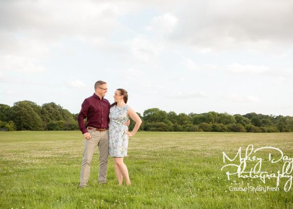 London engagement photography London wedding photographer mykey day sunset green grass and blue skies