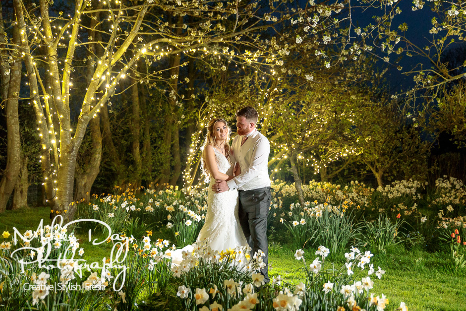 Old Kent Barn Wedding Photography | Fairy lights wedding photo